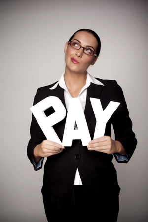 A income concept image of a woman holding letters that spell out the word pay demonstrating fare pay for woman  photo