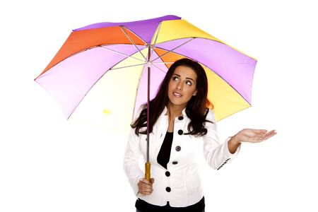 A beautiful woman wearing blue jeans holding a colourful umbrella on a white background  photo