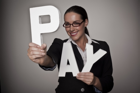 fare: A income concept image of a woman holding letters that spell out the word pay demonstrating fare pay for woman