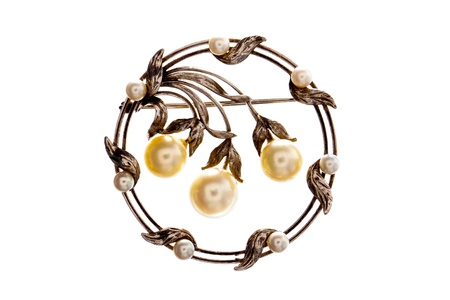 broach: An antique Victorian pearl and silver broach isolated on a white background