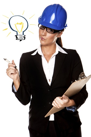 A beautiful woman wearing a hardhat thinking up a idea  photo