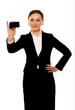 A businesswoman holding a blank black business card in her hand   photo