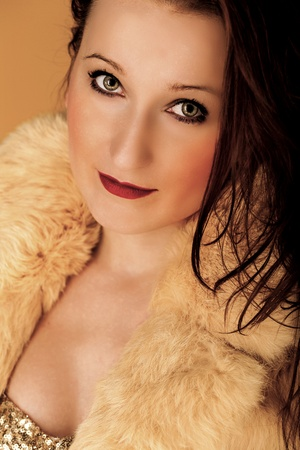 A sexy woman wearing a fur coat with red lips  photo
