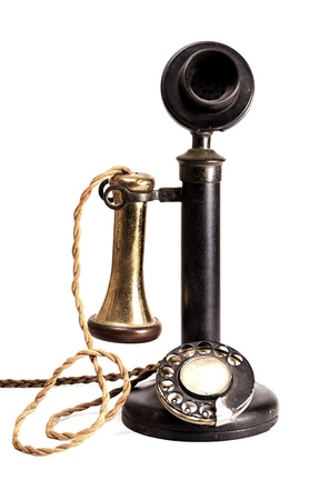 A old antique telephone on a white background.