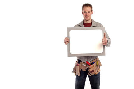 A young man wearing a tool belt and holding a white signboard for advertising  photo