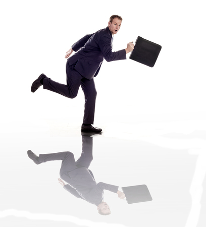 A businessman running with a briefcase photo
