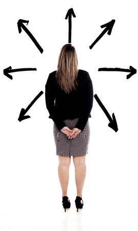 Businesswoman standing in front of black arrows to pick a direction to take   photo