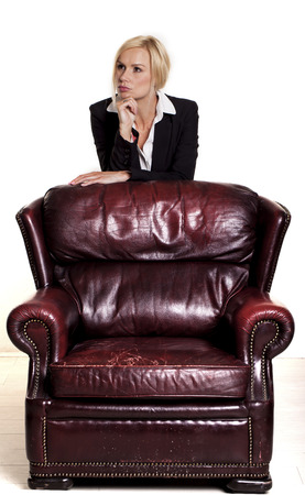 old leather furniture businesswoman siting on a old brown leather chair stock photo