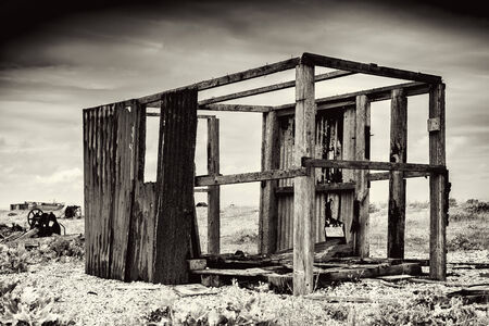 dilapidated: Wooden building that is badly dilapidated in black and white