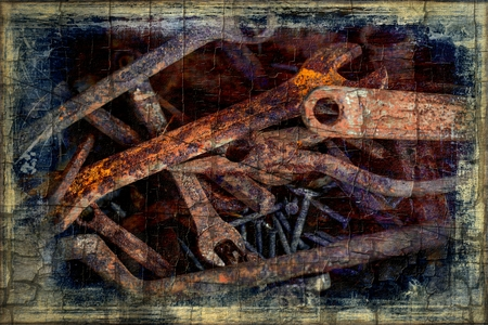 Old rusty spanner as a abstract industrial background  photo