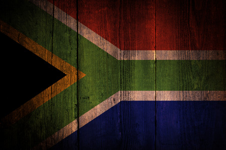 An South African flag on a grunge wooden background Imagens - 29871210