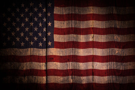An American flag over a grunge wooden background  photo
