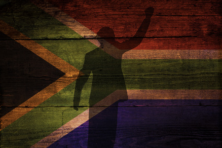 An South African flag on a grunge wooden background with a shadow overly for freedom  Stock Photo