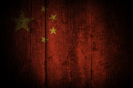 Chinese flag over a grunge background  photo