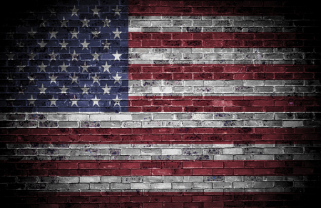American flag over a grunge brick background  photo