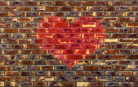 Abstract image of a brick wall with a red heart overlay  photo