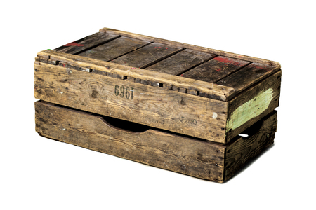 boxed: Old vintage wooden crate over a white background.