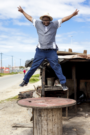 township: Black South African man in a township. Stock Photo
