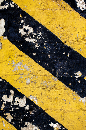 Dirty grunge image of a dirty chevron in black and yellow. photo