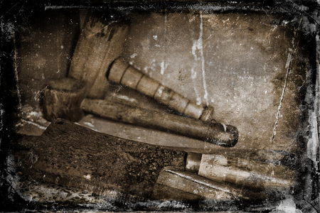 Abstract grunge image of a collection of old vintage and rusty tools. photo
