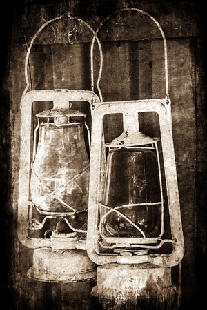 Abstract image with a grunge effect of two old vintage paraffin lamps. photo