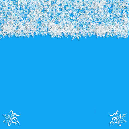 Christmas frame with drawn snowflakes and ivy corners in white over a blue background. photo