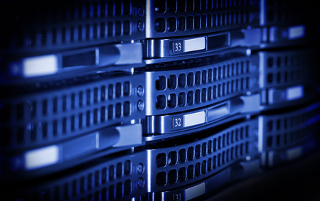 drives in information: Hard drives in data center storing information. Stock Photo