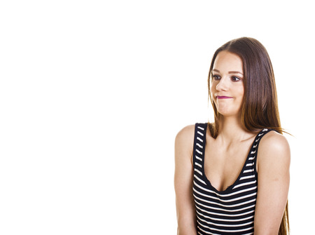 Casual young woman over a white background. Standard-Bild