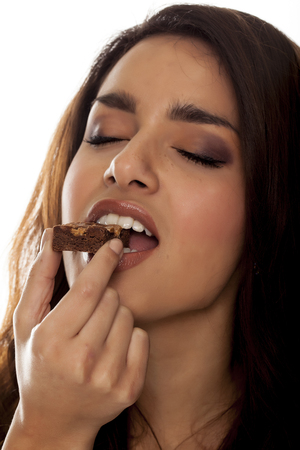 Beautiful woman eating chocolate.