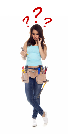 Confused woman with tools over a white background.