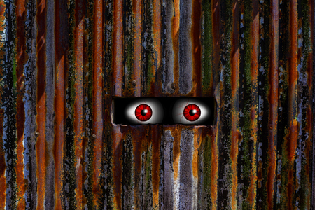 spooky eyes: Abstract image of spooky eyes looking trough a hole. Stock Photo
