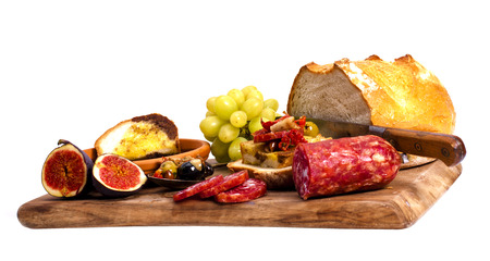 Antipasto catering platter with salami and cheese on a wooden board.