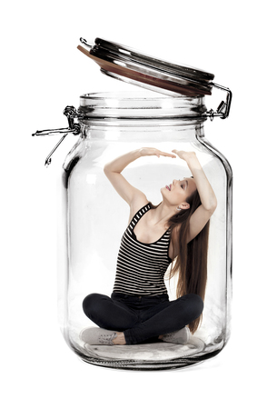 Woman trapped in glass jar.
