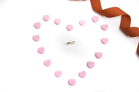 Engagement ring in center of candy hearts