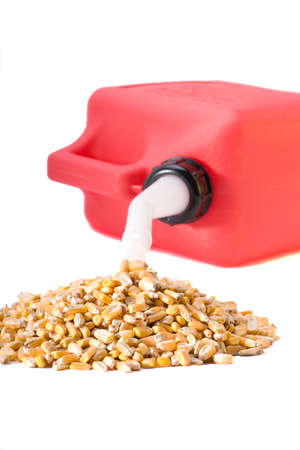 gas can: Corn pouring out of gas can representing the source of ethanol Stock Photo