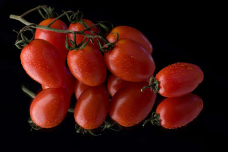 Vine ripened tomatoes with dew
