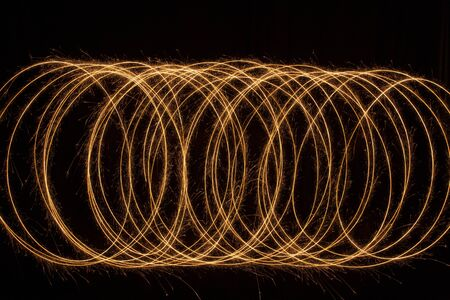 Sparkle golden glowing shiny spiral lines and circle light effect. Abstract Glowing light fire ring trace.