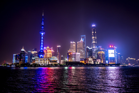 Shanghai, China - May 8 2019 : Night scene skyscrapers and skylines in Shanghai. Skyline night view from Bund waterfront on Pudong New Area, Shanghai.