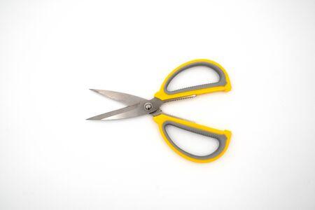 Yellow grey handle scissors isolate on white background. Paper, art, multipurpose cutting.