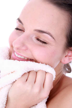 wellbeeing: girl with fres washedtowel looking at camera