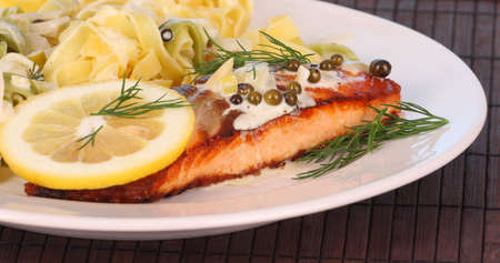 broiled: broiled salmon and ribbon noodles  Stock Photo