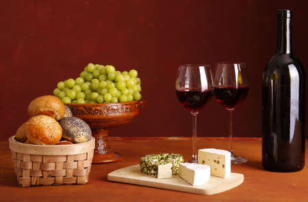 red wine, cheese, bread and grapes photo