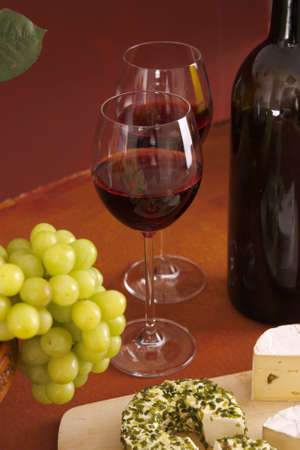 red wine, cheese and grapes photo