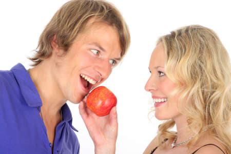 contentedness: couple in love  feeding an apple