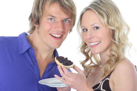 contentedness: couple having breakfeast Stock Photo