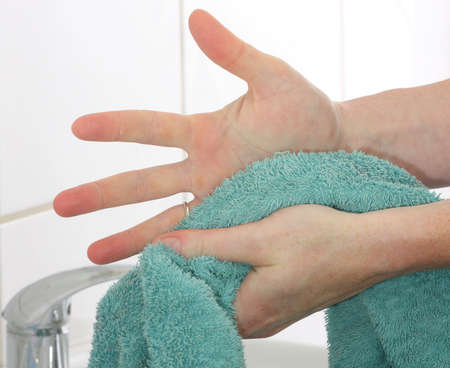 hand towel: Drying hands using a towel Stock Photo