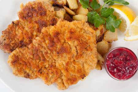 schnitzel: Wiener schnitzel with potatoes and cranberry