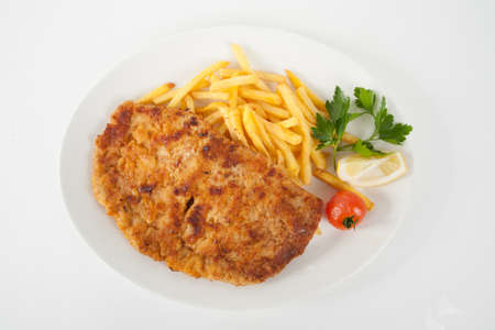 Wiener Schnitzel with french fries Stock Photo