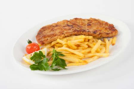 schnitzel: Wiener Schnitzel with french fries Stock Photo