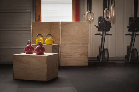 gym dress: colorful kettlebells on cross fit boxes Stock Photo